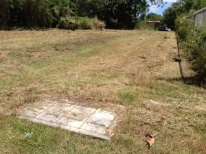 Cleared flat lot with access to water/power and sewer.