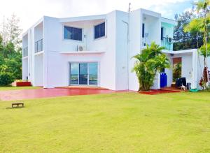 Rear view of home with panoramic ocean views