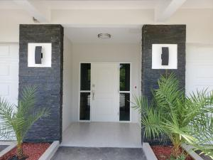 A covered portico welcomes you to luxurious living.
