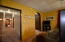 View of long hallway to the living areas of the house from the master bedroom
