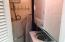 Utility room - hot water tank and washer/dryer