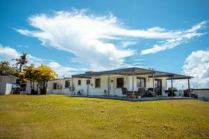 A Feel Good Family Home Amongst the Greens in the Private Estates of The Windward Hills Golf Course