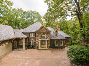 Situated on over 1 acre, privacy and surrounding woods highlight this unique one of a kind home.