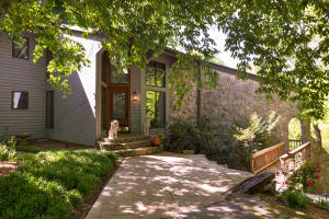 Large contemporary lake home on private 3+ acres.