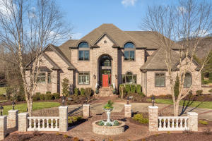Stunning all brick home with basement located on 7.64 acres
