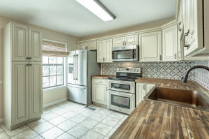 Beautifully renovated kitchen featuring new tile flooring, all new cabinetry, new stainless steel appliances, new hardware, new countertops, and new paint!!