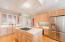 The cook's dream kitchen features stainless appliances, island, plenty of cabinet and counter space