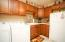 Mudroom/laundry room/pantry with sink, extra fridge, tons of cabinets and storage for shoes and jackets