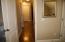 Beautiful hardwood flooring through hallway.