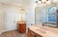 Master bathroom has separate vanities and his and her closets!