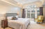 Master suite with special detail to ceilings and windows. Beautiful scenic view through artistic over-sized window.
