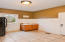Just off the garage as you enter is this most convenient mud room enjoyed by current owners. Has a locker area and room for a refrigerator.