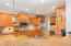 Entertaining is fun in a kitchen equipped for the discriminating buyer. Spacious and open kitchen features granite counter-tops; wood cabinets with pull-out shelves in bases; small desk area; and plenty of storage.