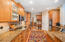 Appreciated features in the kitchen include hardwood floors, Bosch appliances, double ovens (including convection), recessed lighting, and walk-in pantry.