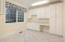 Laundry room was designed to accomplish a multitude of family functions - crafts, sewing, study area, mom's command center . . .