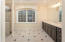 Fourth bedroom offers expansive private bath and closet