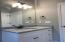 Beautiful granite, white cabinets, & tub/shower combo.