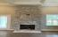 A beautiful feature of this home is the floor to ceiling stone fireplace in the great room!