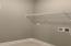 Tiled laundry/mud room with storage shelf!