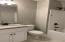 Beautiful granite, white cabinets, tub/shower combo.