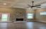 Coffered ceiling, hardwood floors, gas log fireplace, and natural light flow - a space you'll love settling into with friends and family.