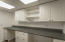 Ample storage in the laundry room.