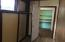hall and storage in between bath and laundry room