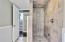 downstairs custom tiled shower