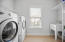 Huge laundry room with tons of shelf space!