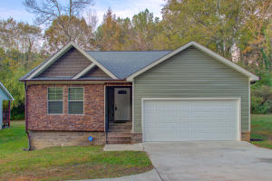 Check out this almost new, single-level home just 10 minutes from downtown Chattanooga. Everything on the main level includes a foyer and the large living room with two ceiling fans and beautiful hardwood floors. The living room is open to the dining room and kitchen with a large laundry room behind the kitchen. All appliances are included. The master suite is in the back of the house with a walk-in closet and an ensuite bath including a double vanity, jetted tub and separate shower. Two additional bedrooms and a full bath are near the front of the house. Check out the two-car garage in the front and the deck back. If you want new-ish with the convenience of downtown without the downtown price tag, make an appointment to visit today.