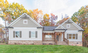 Charming Home with large front porch. Features cedar and brick accents.