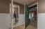 Basement bathroom with door leading to storage room
