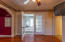 Master bedroom with french doors leading to the sunroom