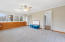 oversized sunroom/den/playroom with access to the deck