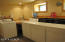 Laundry room with 2 sets of washer/dryers