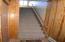 stairway from front door and garage door to condo living area