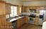 Kitchen with Maple cabitnets and stainless appliances.