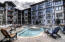 Heated Amenity Deck with long chairs, 40-person hot tub & gas fireplace