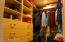 One of two closets in Master Bedroom; both with custom inserts!