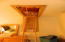 Attic has convenient pull down ladder, a plywood floor and lighting