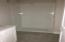 Quartz countertops and glass shower doors will be installed