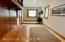 Entry Hall, leads to garage and upper level family room