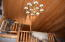 The tall ceiling allows a large chandelier to light the way to the west end of the living area.