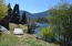 The large lot allows a bridge over to the fire-pit, kayak launching area, fishing area and bunkhouse.