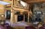 The dining room adjoins the tv area, massive wood burning fireplace, pool table and wet bar area.