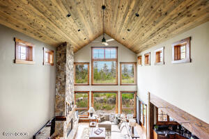 This inviting home has soaring ceilings, dramatic windows, open floor plan, views from every window and is just steps from an extensive trail system and close to downtown WP and the ski resort