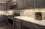 Kitchen includes soft close cabinetry and beautiful quartz countertops