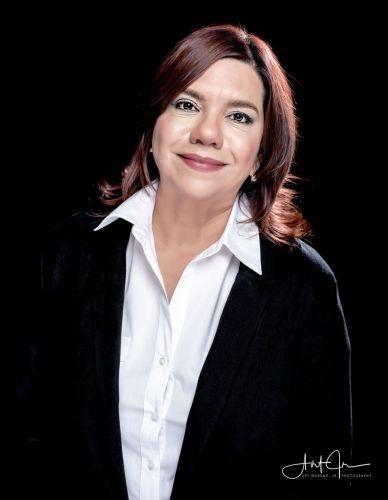 Flor Espejo agent image