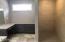 Custom tiled shower and make up counter