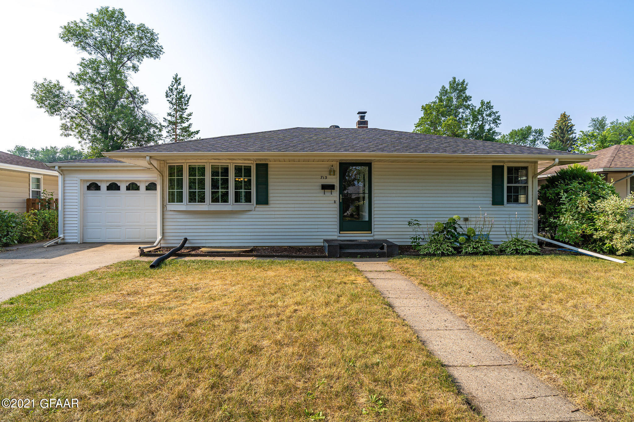 Great southend home in heart of Grand Forks! This updated home features 4 bds, hardwood floors, remodeled basement, and sunroom. The kitchen comes with stainless steel appliances, window into sunroom and room for a table. During the summer months entertain on your large patio in your large fenced in backyard with alley access. Radon mitigation system. Tons of natural light and storage.